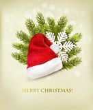 Holiday background with a santa hat and Christmas tree. Stock Image