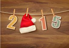 Holiday background with 2015 and a santa hat. Royalty Free Stock Images