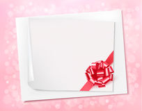 Holiday background with sheet of paper and pink bo Stock Photography