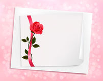 Holiday background with sheet of paper and a rose. Stock Photography
