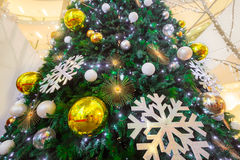 Holiday background. Shopping mall interior decorated with christmas trees Stock Image