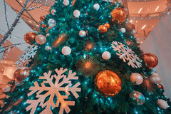 Holiday background. Shopping mall interior decorated with christmas trees Royalty Free Stock Photos