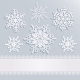 Holiday background with snowflakes and white stripe with lace Stock Photo