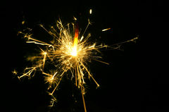 Holiday background with a sparkler. Stock Photography