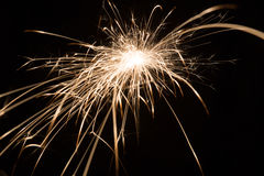 Holiday background with a sparkler Stock Images