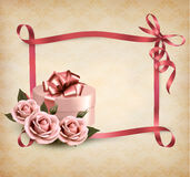 Holiday background with three roses and gift box a Stock Images