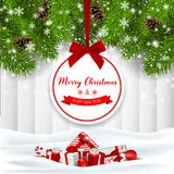 Holiday background with tree branches, red gift boxes and label royalty free stock photography