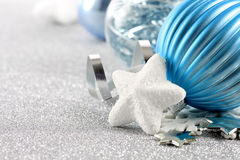 Holiday background with white snowflake and blue Christmas ornaments Royalty Free Stock Photography