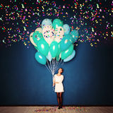 Holiday Background. Young Woman,  Balloons and Confetti Stock Photos