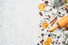 Holiday baking background. For baking Christmas cookies with cutters, rolling pin and spices on white marble table covered with snow. Top view with copy space stock images