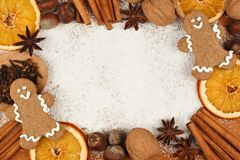 Holiday baking frame with gingerbread men, nuts, spices Stock Image