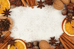 Holiday baking frame with nuts, spices and powdered sugar background Stock Images