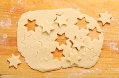 Holiday baking. Pastry and star shape cookies baking royalty free stock photo