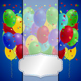 Holiday balloons with red ribbon on orange background. Royalty Free Stock Photos