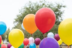 Holiday, balloons rushing up, colorful flags. Colored balloons, Holiday, balloons rushing up, colorful flags. Against the blue sky royalty free stock photos
