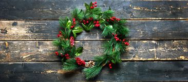 Holiday Banner Green Christmas Decorative Wreath royalty free stock photo