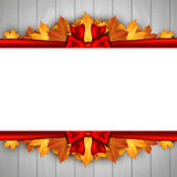 Holiday banner on wooden wall with autumn leaves and red bow. Autumn background. Stock Images