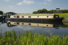 The holiday barge. A large barge moored on a canal Royalty Free Stock Image