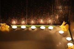 Holiday bath with candles and flowers royalty free stock photo