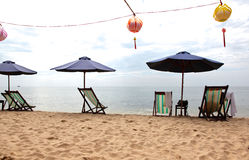 Holiday beach chairs umbrellas lanterns Royalty Free Stock Photos