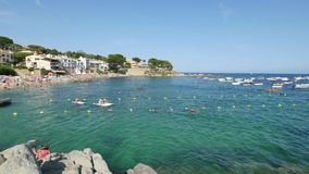 Holiday on the Beach in Spain in Summer. Typical Mediterranean beach in Summer day stock video footage