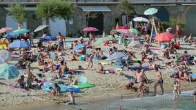 Holiday on the Beach in Spain in Summer. Typical Mediterranean beach in Summer day stock video