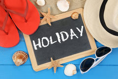 Holiday on the beach in summer with sea shells Stock Photos
