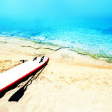 Holiday beach sunny seascape with surf desk, sand and ocean. Sum Royalty Free Stock Images