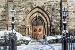 Holiday Beauty. Holiday wreathes and lantern lights welcome visitors to the First Reformed Church of Schenectady, New York Royalty Free Stock Photos