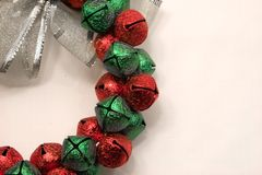 Holiday Bells. Green and red bells in a wreath form ready for holiday cheer Stock Image