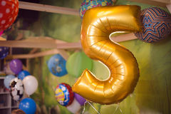 Holiday birthday balloon 5 years Royalty Free Stock Photos