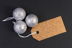 Holiday blank golden tag or label with silver balls stock photo