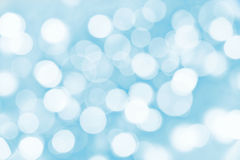 Holiday blue background with blurred lights. Holiday blue background with blurred bokeh lights stock image