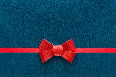 Holiday blue background with red ribbon Royalty Free Stock Photo