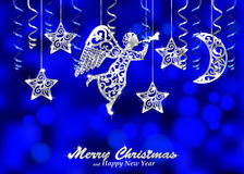 Holiday blue background with silver figures of angel, stars and. Christmas background decorated with paper streamers and fillet silhouettes of blowing angel Stock Images