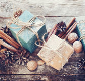 Holiday Blue, Beige Boxes with Cord, Cinnamon, Pine cones, Walnuts Royalty Free Stock Photography