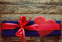 Holiday blue gift box with red ribbon and heart Royalty Free Stock Image