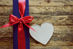 Holiday blue gift box and white heart Royalty Free Stock Photos