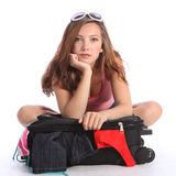 Holiday blues for teenager girl fed up packing. Beautiful brunette young teenager school girl sitting on floor with suitcase looking fed up and tired of packing stock images