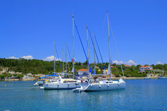 Holiday boats in blue sea water Royalty Free Stock Photo