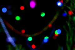 Holiday bokeh. Abstract Christmas background. Blurred multicolored garland