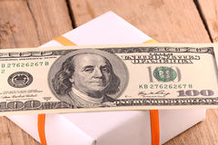 Holiday bonus.  american money on green gift box Royalty Free Stock Images