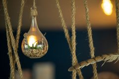 Holiday border of light garland top view. Brown rope light bulb background. Place for text.  stock photography