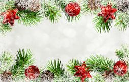 Christmas tree twigs, cones, balls and snowflakes frame. Holiday borders with Christmas tree twigs, cones, balls and snowflakes frame royalty free stock images