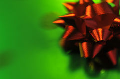 Holiday Bow. A red bow on green wrapping paper Stock Image