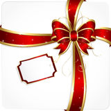 Holiday bow with tinsel Stock Photography