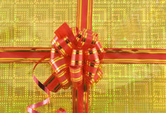 Holiday bow on yellow background Royalty Free Stock Images