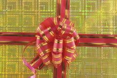 Holiday bow on yellow background Royalty Free Stock Image