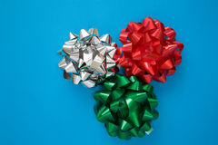 Holiday Bows. Selection of foil bows used for decoration and packages Stock Photos