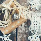 Holiday Box, Jingle Bell and Natural Twine on Stock Photo